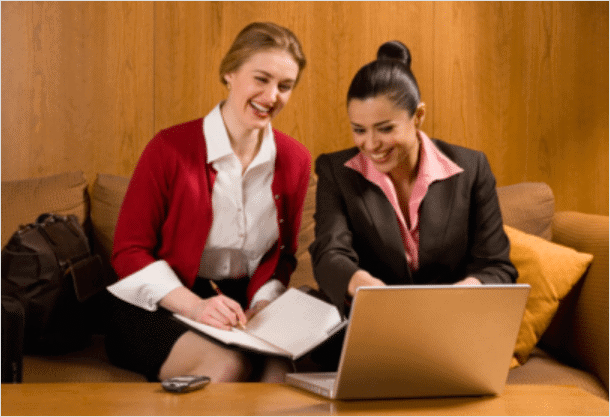 women-using-laptop-of-coffee-table